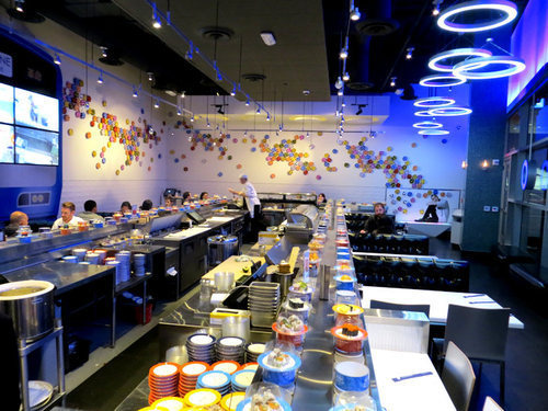 A Rotating Belt Carries Dozens Of Ready Made Sushi Plates Continuously Around The Dining Area