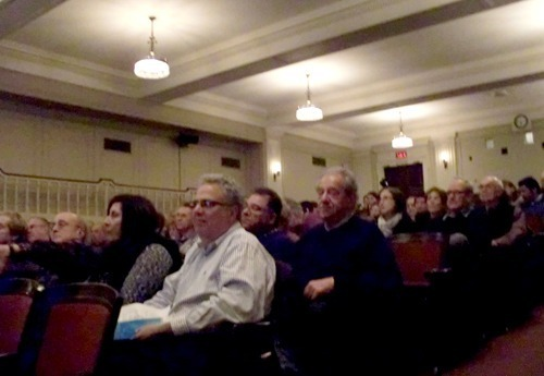 Audience listening intently