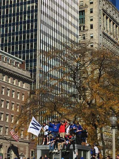 """3080c9f44bf ... Chicago Cubs victory."""" Fans took to higher grounds along the streets in  order to see their favorite players pass by"""