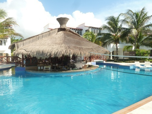 The Swim Up Bar And Pool Area Are Center Of Days Social Activities