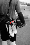The Klitch a FOOTWEAR CLIP that allows you to hang extra footwear to the outside of your bag
