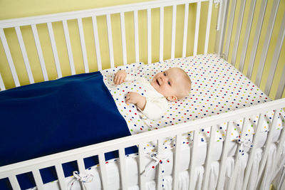 Baby feels gently swaddled and sleeps better in the Snap Cozy™ Crib Blankets