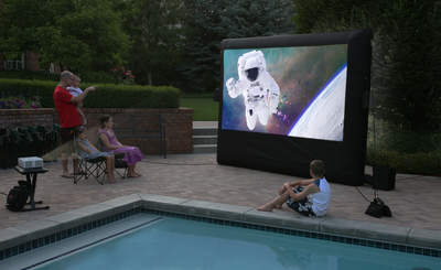 The CineBox Home backyard drive-in kit includes an inflatable movie screen and all the equipment needed to launch an outdoor movie-watching party anytime