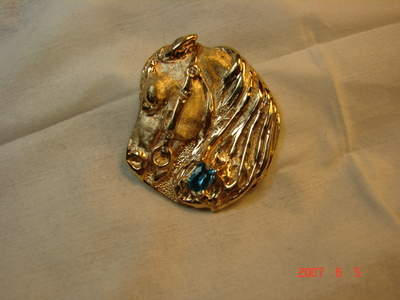 Horse pendant with diamonds and topaz