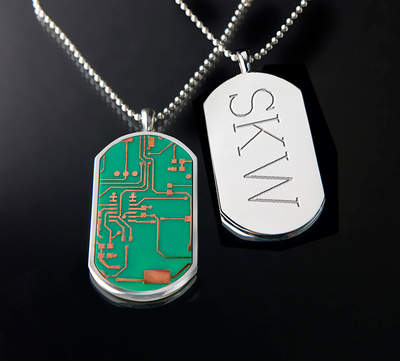 Motherboard Dog tags in sterling silver casings expand the constellation of gifts now offered by the Chicago-area firm that has made its name manufacturing high-end gifts since 1991.