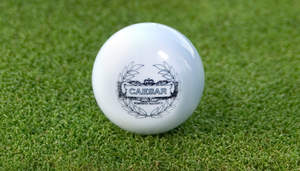 The Caesar Featherie, the world's first dimple-less golf ball.