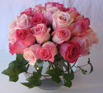 Avalanche of Emotion-Soft pale pinks and mauves and creams in an opulent bouquet of roses in a glass bowl. Accents of eucalyptus and trailing ivy.$125.00