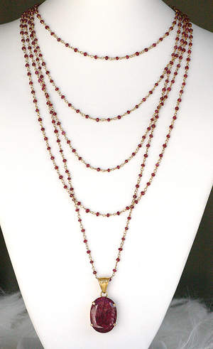 5 strands of ruby and garnet with a ruby pendant