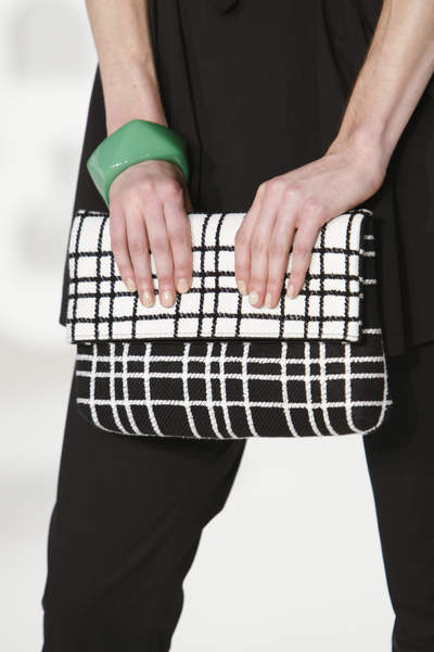 THE WORTH COLLECTION'S BLACK AND WHITE BOUCLE CLUTCH