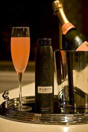 Mix Rubyy and champagne for energy-infused mimosas