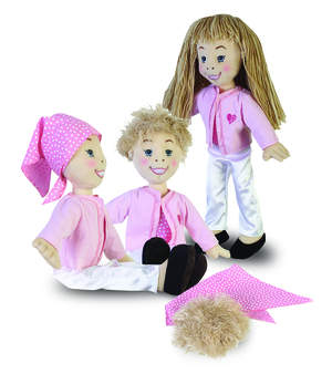 Dolls reflecting various stages of hair loss and growth due to cancer treatments