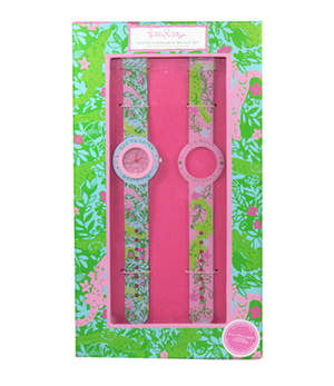 This adorable watch set is nostalgic with a Lilly twist! Mix up your accessories with this wild pair of patterned watch bands, complete in a colorful gift box. Two for the price of one! Around the face of the blue background band it says