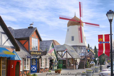 Solvang's iconic windmill surrounded by boutiques and wine tasting rooms and restaurants and bakeries and more!