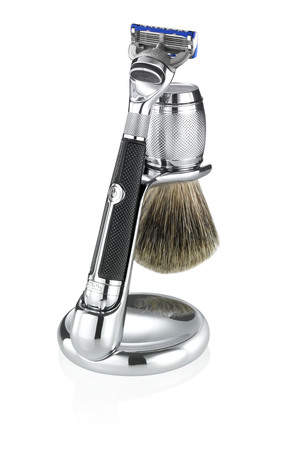 The Fusion Chrome Collection ProGlide Power Razor in its stand with the Badger Brush