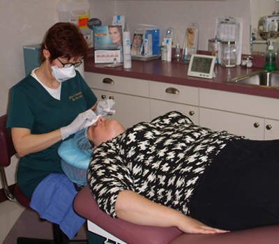 A picture of one of our clients getting her first medical facial