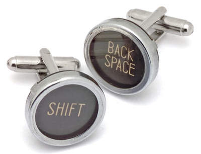 Black typewriter key cuff links with expressions. No two pairs are exactlyl alike.