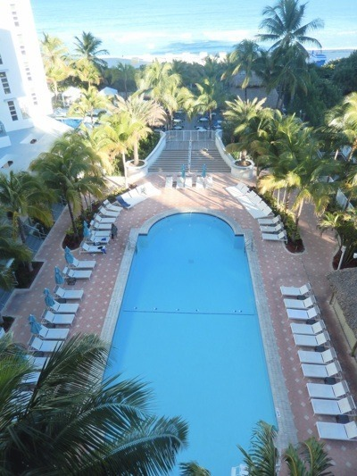 The Two Pools And Tiki Bar Full Of Palms Gives Property A Resort Feel