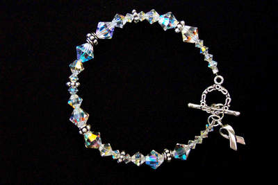 A gorgeous combination of Swarovski crystals of varying sizes and sterling silver beads. This bracelet has a sterling silver toggle clasp and a sterling silver ribbon, and is available in an 8