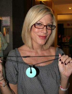 Mom Tori Spelling with her Teething Bling