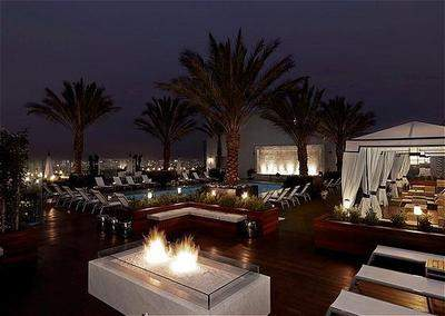 Enjoy the Valentines Day three-course menu with champagne served in a cabana at The London West Hollywood's rooftop pool deck.