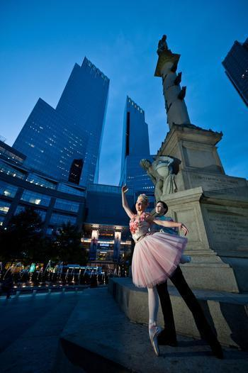 Dancers perform a romantic ballet in Columbus Circle for audiences on THE RIDE.